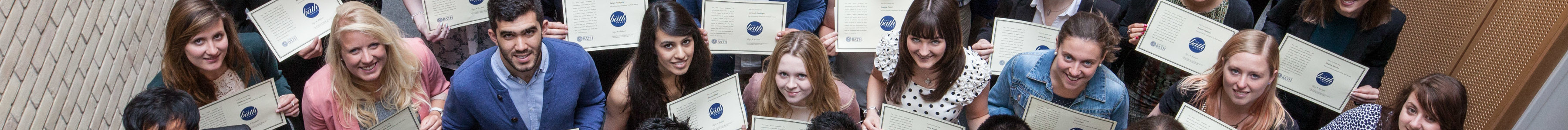 Students showing off their Bath Awards at Bath Uni